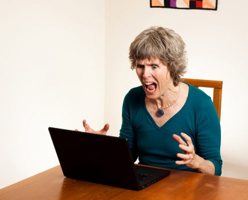 Woman frustrated by her computer